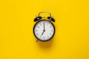 alarm clock shows hour yellow background leadoo pricing Pricing_Current