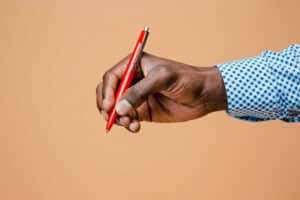 male hand holding pencil isolated leadoo pricing Pricing_Current